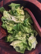 A simple green salad in vinaigrette